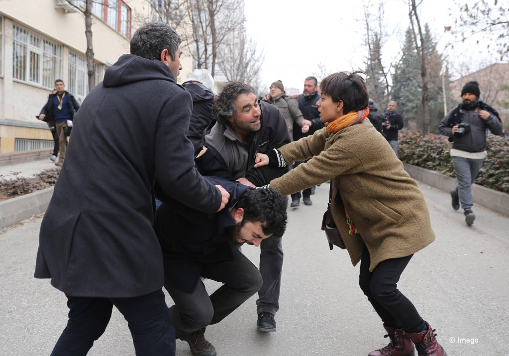 Riot police detain a demonstrator during a protest against the dismissal of academics from universities following a post-coup emergency decree, outside the Cebeci campus of Ankara University in Ankara, Turkey, February 10, 2017. | Photo: Imago / Depo Photos